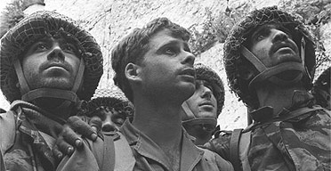 "famous picture of four paratroopers who participated in the fight staring at ""the wall"" (hakotel) the most revered spot in Judaism, probably for the first time in their lives."