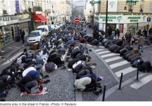 Muslims praying on city street. Stop traffic, prevent stores from doing business unless they are muslim business, proprietors get angry about it.