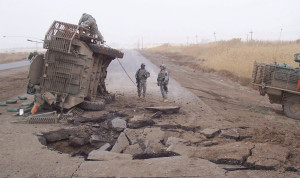 This is the result of an IED. If it can do this to the road and to that military vehicle, just imagine what it will do to a car load of families escaping for their lives.