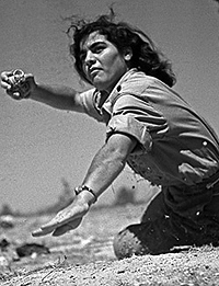 Israeli woman soldier in the act of throwing a hand grenade. Cool huh? Sort of reminds you of those battling broads of today's Kurdish assault on ISIS. One of many similarities between that time in Israel and today in Kurdistan redeemed.